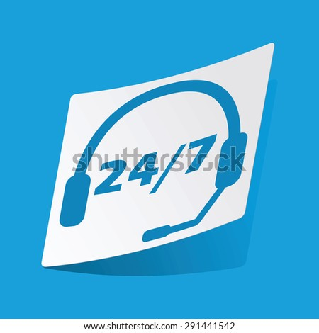 Sticker with headset image and text 24 per 7, isolated on blue - stock photo