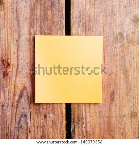 sticky note and a pencil  on the wooden table - stock photo