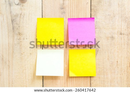 sticky note attach to a wooden wall