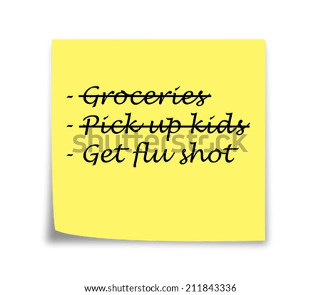 Sticky note reminder to get flu shot, black on yellow - stock photo