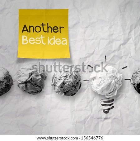 sticky note with another idea light bulb on crumpled paper as creative concept - stock photo