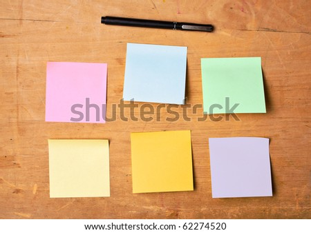 sticky noted with black pen on wooden board