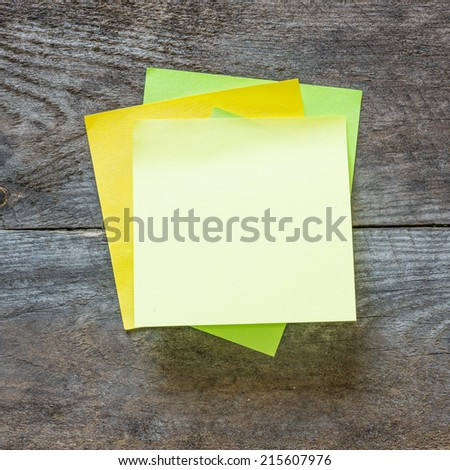 Sticky notes isolated on wooden background with clipping path. Above view - stock photo