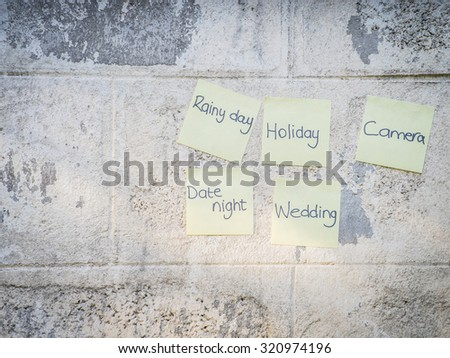 sticky notes on a wall - stock photo
