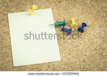 sticky notes on cork bulletin board. - stock photo