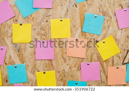 Sticky notes on the board - stock photo