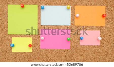 sticky notes over brown cork background