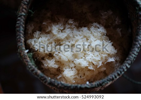 Sticky rice in a wicker in the darkness.