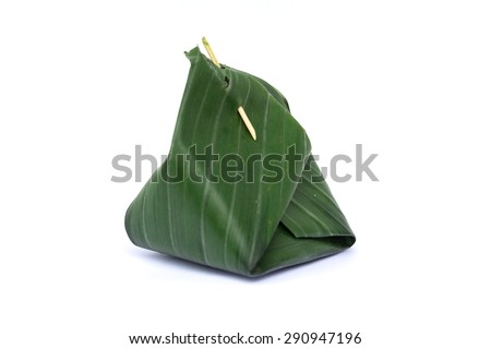 Sticky rice Thai custard is Thai dessert which wrap by banana leaf, within banana leaf is contain Sticky rice Thai custard