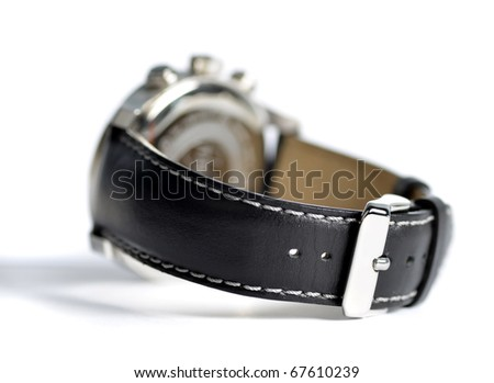 Stil life picture of black leather wristwatch