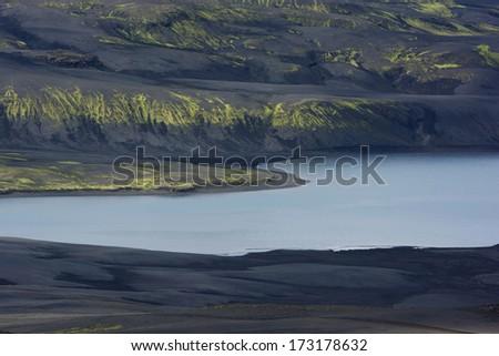 Still lake among black hills covered with volcanic ash, Lakagigar, Iceland - stock photo