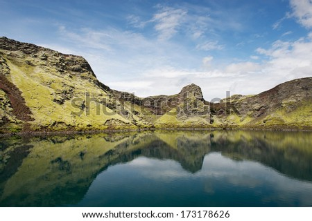 Still lake in a crater with reflections, Lakagigar, Iceland - stock photo