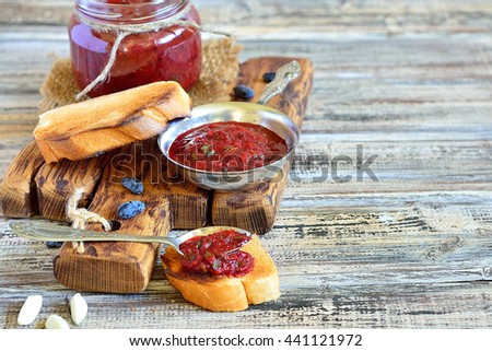 Still life - a sauce made from red peppers, garlic and berries of honeysuckle - stock photo