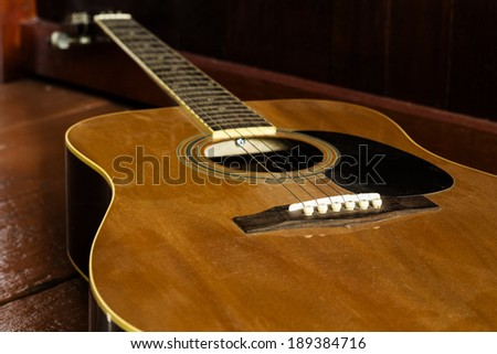 still-life Acoustic Guitar on wood background,Music - stock photo