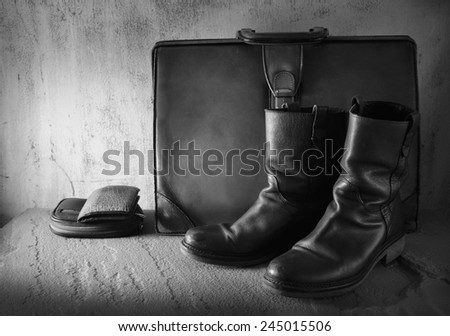 Still life art on casual concept with boots wallet purse case black and white version