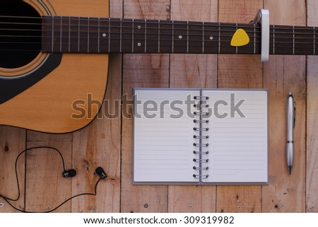 Still life art photography music and memories concept with guitar, notebook,pen, - stock photo