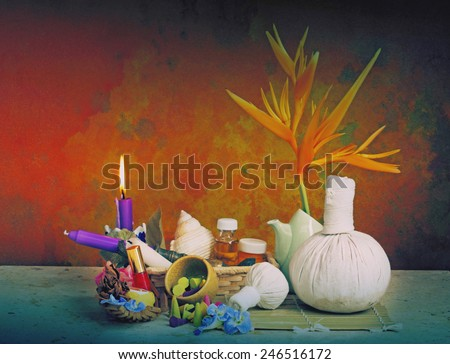 Still life art photography on spa concept with candle light and herbal massage balls - stock photo