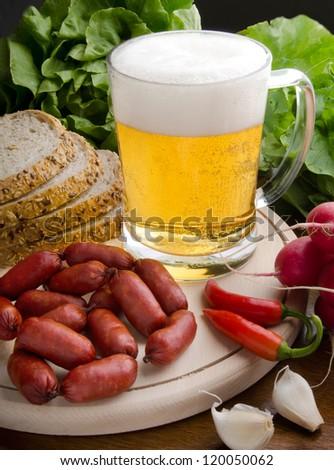 Still life beer mug and rustic dinner - stock photo