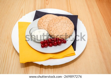 still life: biscuits on a plate on wooden table - stock photo