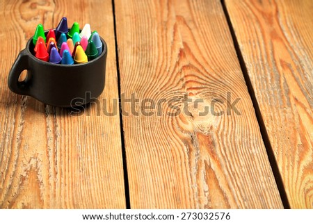 Still life, business, education concept. Crayons in a mug on a wooden table. Selective focus, copy space background - stock photo