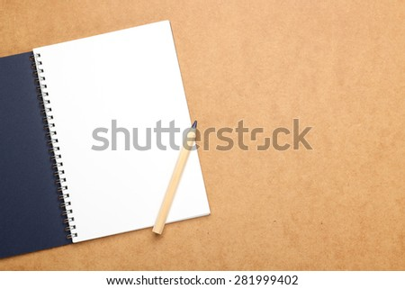 Still life, business, education concept. Office supplies, notepad and a pencil on a table. Selective focus, copy space background, top view - stock photo