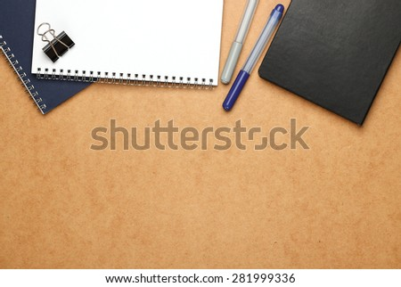 Still life, business, education concept. Office supplies, notepad, diary, staple and pens on a table. Selective focus, copy space background, top view - stock photo
