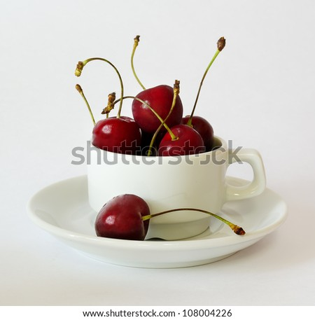 Still life cherry in a white cup - stock photo