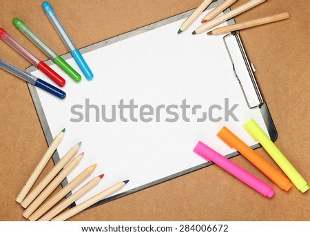 Still life, children, school, education concept. Stationery, markers and pencils on a table. Selective focus, copy space background, top view