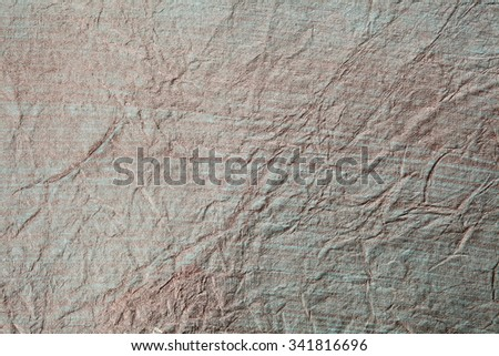 Still life close up detail of a shiny silvery black and white rough wrinkled piece of paper with lines and texture. Gray full frame background with splashes detail. Monotone colorless blank page. - stock photo