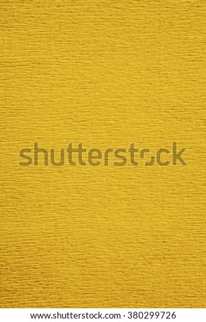 Still life close up detail of a wrinkly golden yellow rough grungy piece of paper with horizontal lines and thick texture. Gold full frame background with texture detail. Monotone backdrop blank page. - stock photo