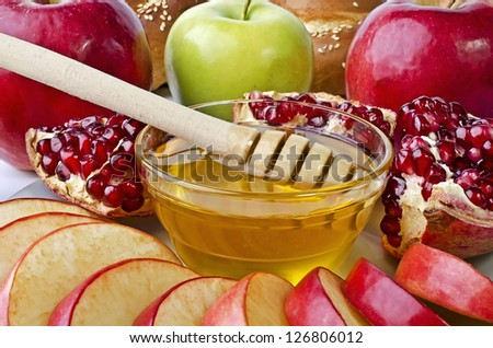 Still life closeup - challah, apples, pomegranate and bowl of honey closeup. Illustration of Rosh Hashanah (jewish new year) or Savior of the Apple Feast Day
