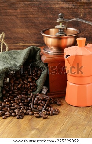 Still life coffee beans in a bag and coffee pot  - stock photo