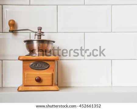 Still Life Coffee Grinder on a Shelf with White Tiles Backgrounds for Business. - stock photo
