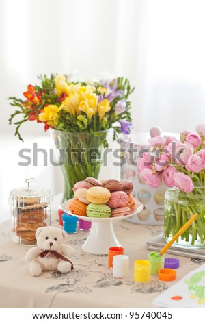 Still life - colorful macaroons, beautiful bouquet of ranunculus, watercolours - stock photo