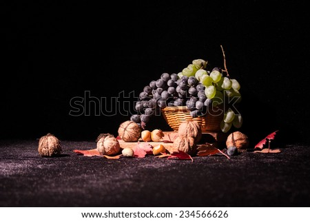 Still life composition with fruits and vegetables on black, dusty surface - stock photo