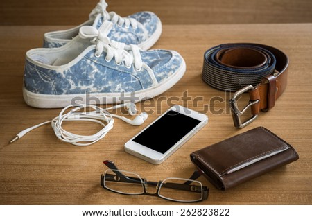 Still life concept of traveling all over the world with mobile phone - stock photo
