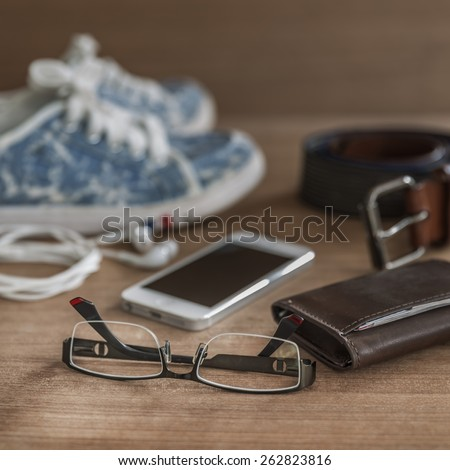 Still life concept of traveling all over the world with spectacles - stock photo