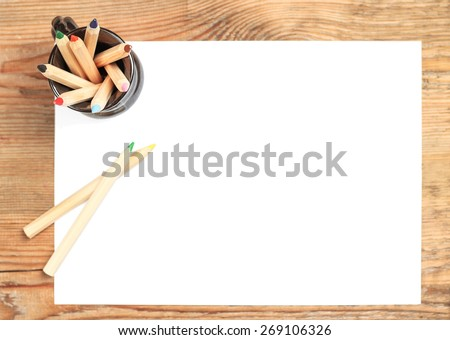 Still life concept. Pencils lying on a paper. Selective focus, top view, copy space background - stock photo
