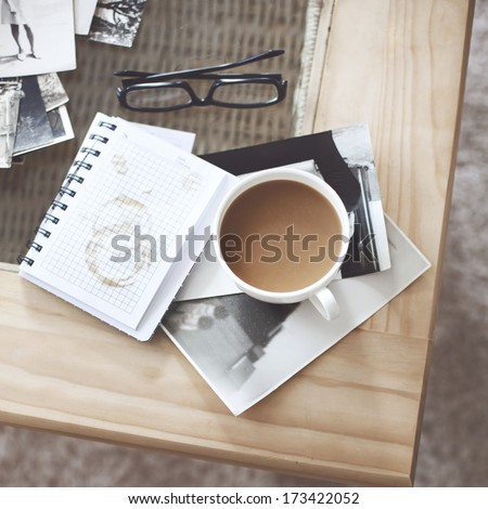 Still life details, cup of coffee and retro vintage black-and-white photos - stock photo