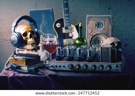 Still life fine art photography on high fidelity concept with vintage tube valve amplifier wine electric guitar and speaker  - stock photo