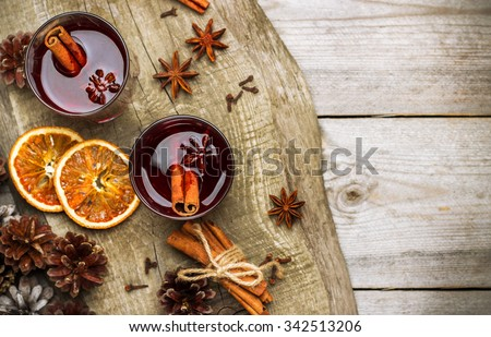 Still life, food and drink, seasonal and holidays concept. Christmas mulled wine on a rustic wooden table. Selective focus, copy space background, top view - stock photo