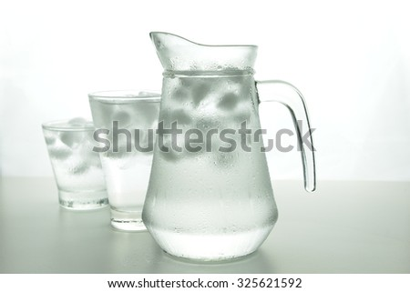 still life fresh water with ice in glassed and water drop by reverse osmosis system  - stock photo