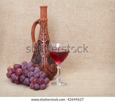 Still-life from a Georgian jug and fruit against a canvas - stock photo