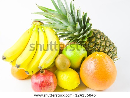 still life from different fruit on a white background