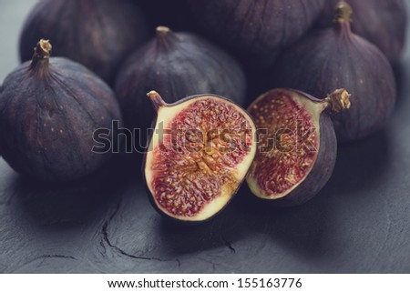 Still life fruits: ripe figs, close-up