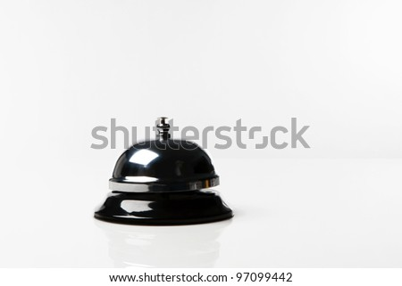 still life image of a service bell on white background