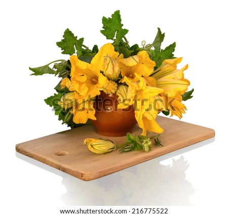 Still Life in potpourri style. Magnificent bouquet of huge orange flowers pumpkin with leaves and buds in ancient clay pot on wooden chopping board isolated on white background with clipping mask - stock photo