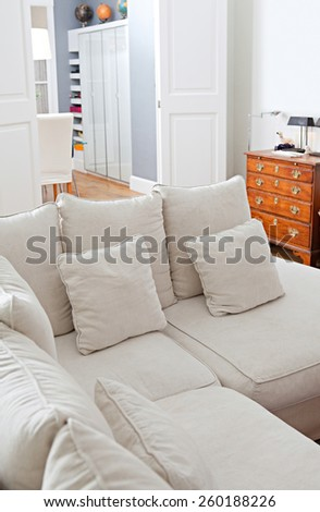 Still life interior design home living room view with a comfortable and welcoming white sofa with cushions, home interior detail. Aspirational and relaxing home family room, indoors living lifestyle. - stock photo