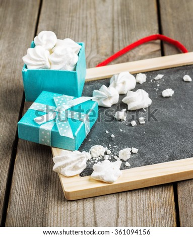 Still life, love and holidays concept. Love and Valentine Day decoration with frame and gift box. Selective focus, copy space rustic wooden background - stock photo