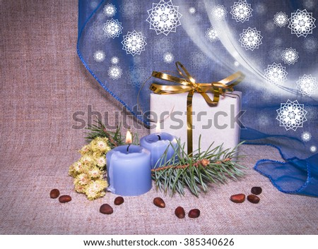 Still life New Year's gift and candles - stock photo